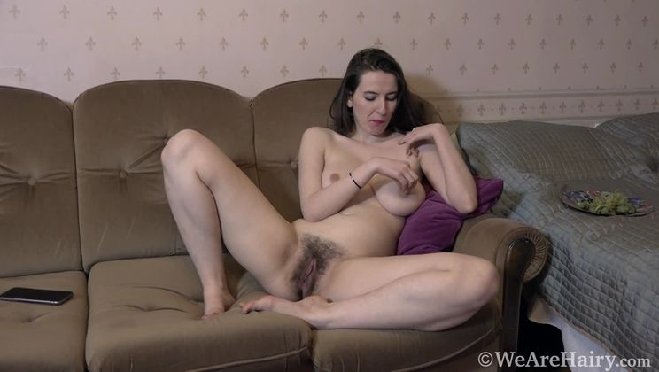 Marika Di is naked and relaxing on her couch
