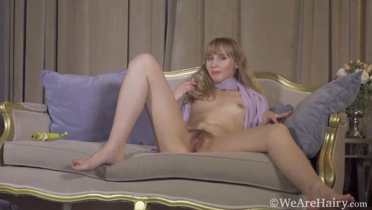 Beatrice strokes the sexy hairs on her body