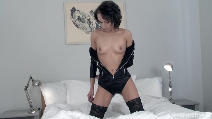 Cleo Dream all dressed in black strips nude in bed