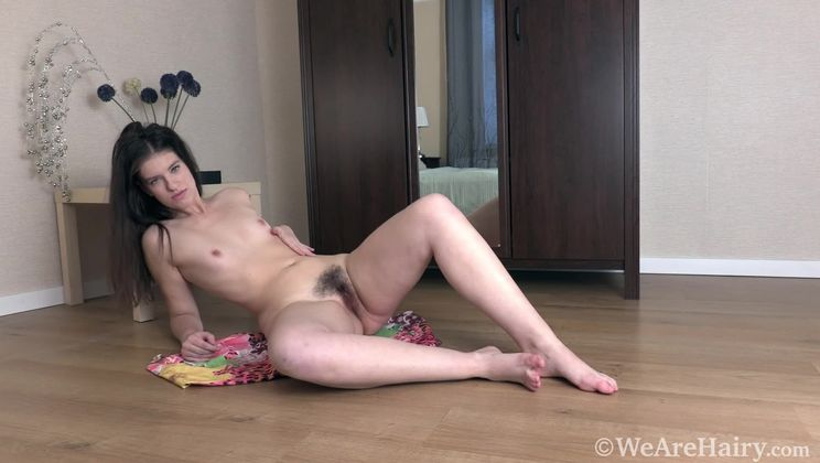 Sabrina A strips naked by her brown mirror