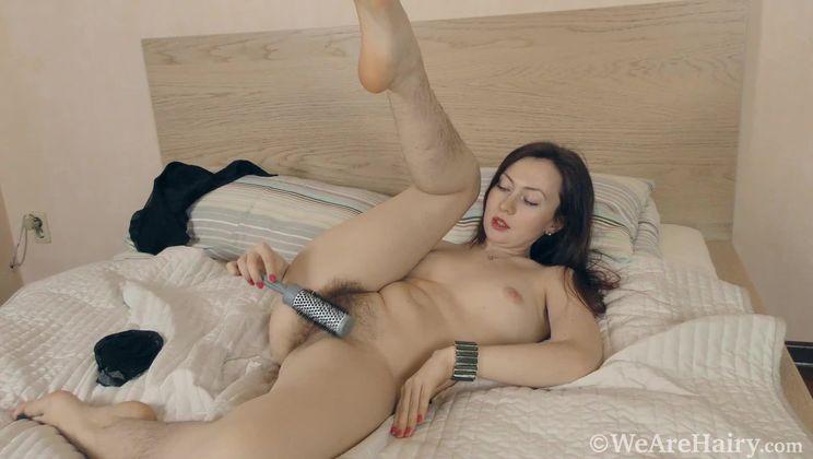 Vita strips naked as she brushes her hairy body
