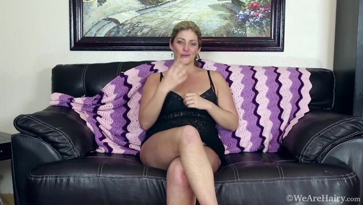Alicia Silver introduces herself on a leather sofa