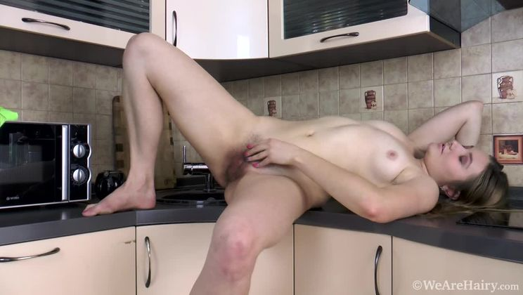 Alessia strips and fondles body in her kitchen