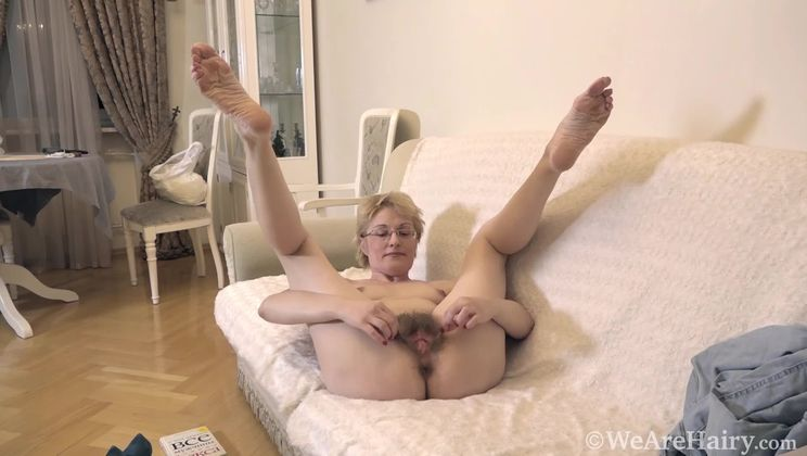 Barbara has fun stripping naked on her chair