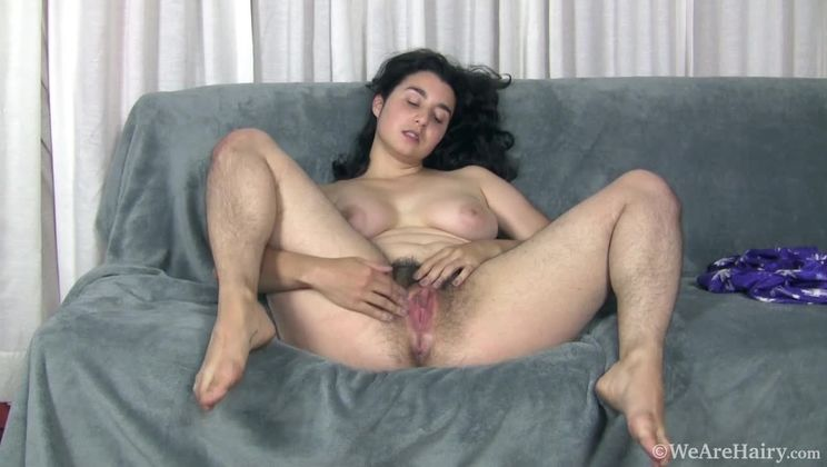 Wara strips naked on her couch to unwind and relax