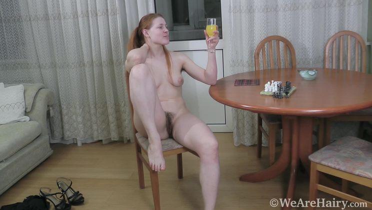 Jana Bay masturbates by her dining table